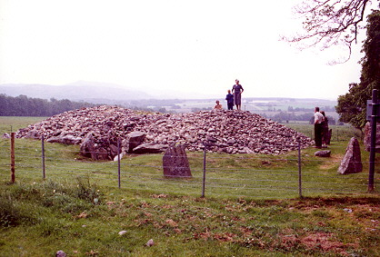 Corrimony cairn with visitors