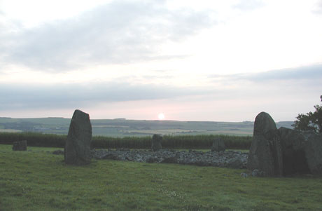 Loanhead of Daviot recumbent stone circle, sunrise close to summer solstice. Copyright Ken Gordon